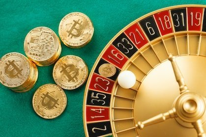 roulette casino and a green carpet with lots of bitcoin expressing that gambling with crypto is possible